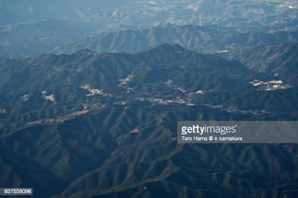 a holy town on mt. koya (koyasan) in wakayama prefecture in japan daytime aerial view from airplane - koyasan stock-fotos und bilder