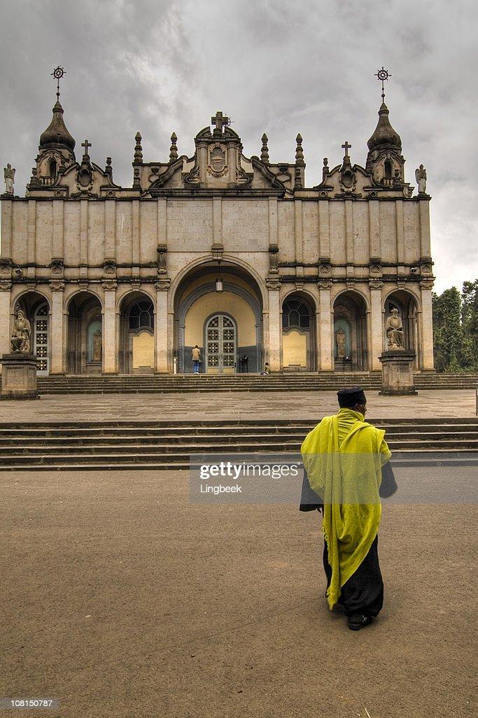 Holy Trinity Church with Orthodox Priest : Stock Photo