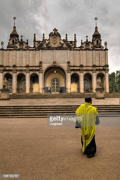 holy trinity church with orthodox priest - ethiopian orthodox church stock pictures, royalty-free photos & images