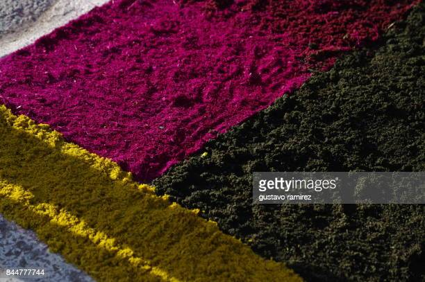 holy week celebration flower carpet - christ is risen stock photos and pictures