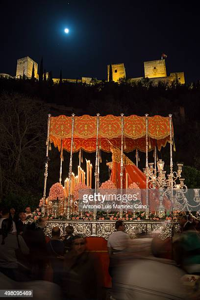 Holy Week in Granada, Easter Monday. Confraternity of Our Lady of Sorrows passing through the Carrera del Darro with the Alhambra in the background...