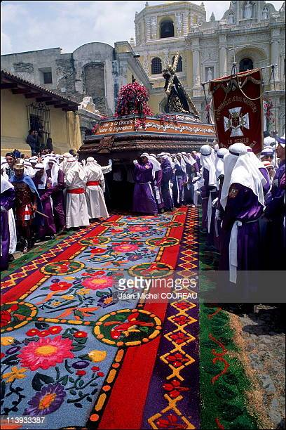 Holy week in La Antigua Guatemala Guatemala in April 1999 Carefully designed hand made carpets cover the cobblestone streets Made from dyed sawdust...