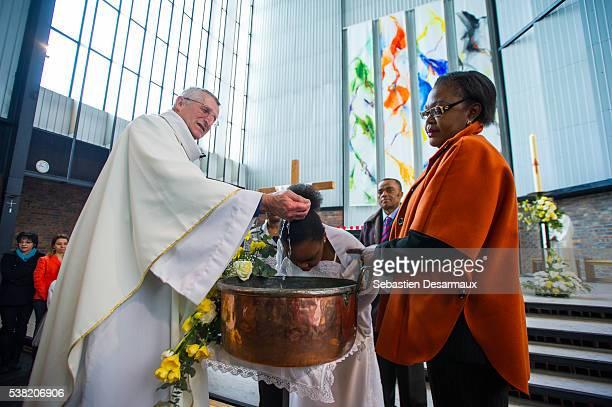 holy week mass. mass. baptism. - catholic baptism stock pictures, royalty-free photos & images