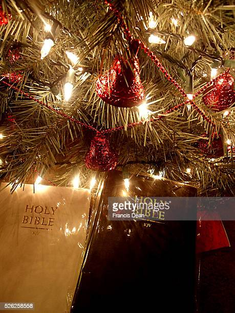 Holybible christmas gift under christmas tree with lights and christmas bells at American home 13 Dec2011