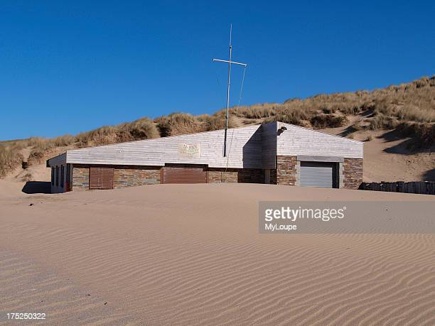 Holywell Bay surf life saving club building partly buried in sand