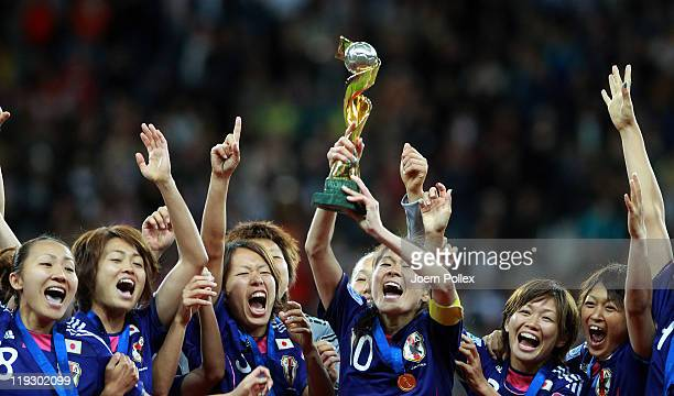 Homara Sawa of Japan lifts the trophy after the FIFA Women's World Cup Final match between Japan and USA at the FIFA World Cup stadium Frankfurt on...