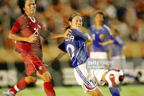 Homare of Japan and Thidarat Wiwasukhu of Thailand battle for the ball during the Olympic Games Final Qualifier match between Japan and Thailand at...