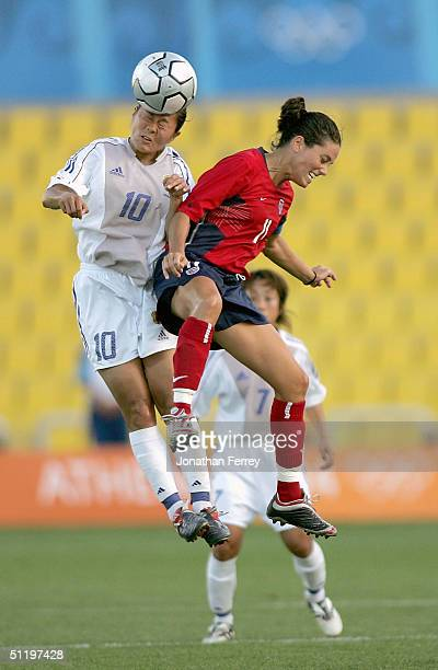 Homare Sawa of Japan heads the ball over Julie Foudy of the United States competes in the women's football quarterfinal match on August 20 2004...