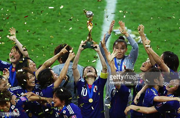 Homare Sawa and her teammates of Japan celebrate their victory of the FIFA Women's World Cup Final match between Japan and USA at the FIFA World Cup...