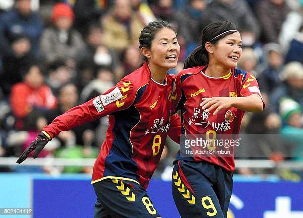 Homare Sawa and Nahomi Kawasumi of INAC Kobe Leonessa celebrate their team's first goal during the 37th Empress's Cup Semi Final match between...