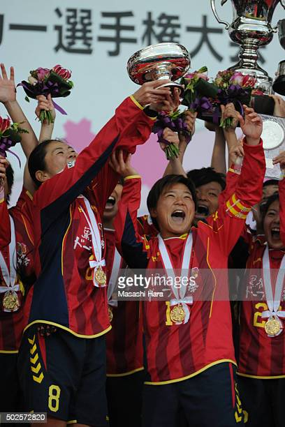 Homare Sawa and Shinobu Ohno of INAC Kobe Leonessa hold the cup after the 37th Empress's Cup All Japan Women's Championship final match between INAC...