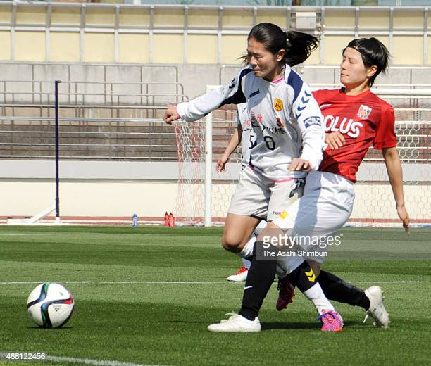 Homare Sawa of INAC and Hikaru Naomoto of Urawa Reds Ladies compete for the ball during the Nadeshiko League match between Urawa Red Diamonds and...