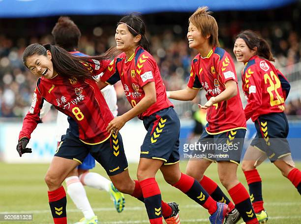 Homare Sawa of INAC Kobe Leonessa celebrates scoring her team's first goal with her team mates during the 37th Empress's Cup All Japan Women's...