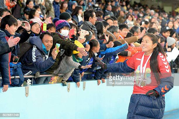 Homare Sawa of INAC Kobe Leonessa high fives with fans after the 37th Empress's Cup All Japan Women's Championship final match between INAC Kobe...