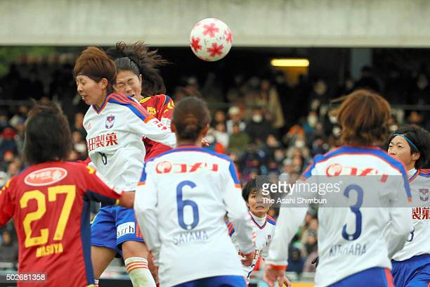 Homare Sawa of INAC Kobe Leonessa scores her team's first goal during the 37th Empress's Cup All Japan Women's Championship final match between INAC...