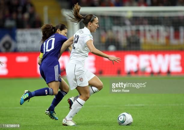 Homare Sawa of Japan and Luren Cheney of USA battle for the ball during the FIFA Women's World Cup Final match between Japan and USA at the FIFA...