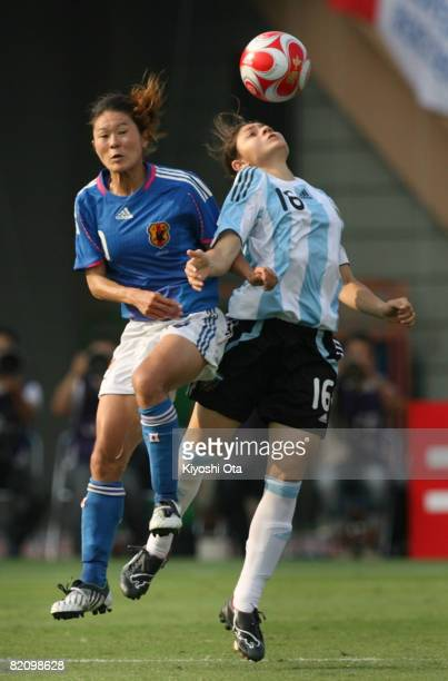 Homare Sawa of Japan and Maria Gimena Blanco of Argentina fight the ball during the women's international friendly soccer match between Japan and...
