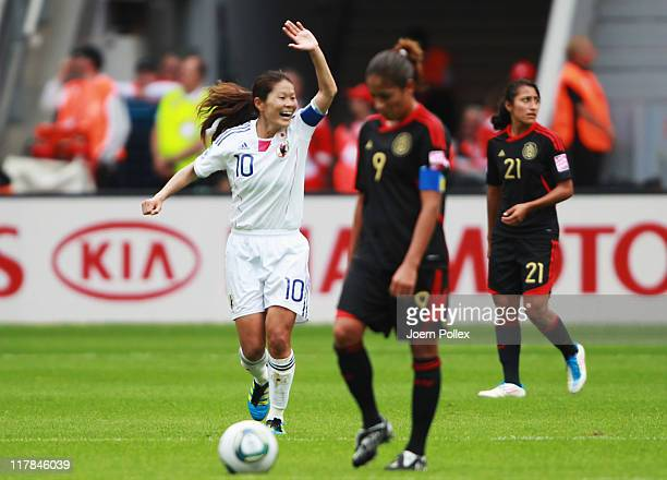 Homare Sawa of Japan celebrates after scoring her team's third goal during the FIFA Women's World Cup 2011 Group B match between Japan and Mexico at...