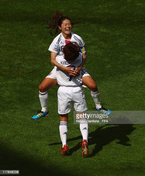 Homare Sawa of Japan celebrates her goal with teammate Nahomi Kawasumi during the FIFA Women's World Cup 2011 Group B match between Japan and Mexico...