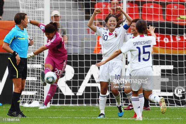 Homare Sawa of Japan celebrates her team's fourth goal with team mates during the FIFA Women's World Cup 2011 Group B match between Japan and Mexico...