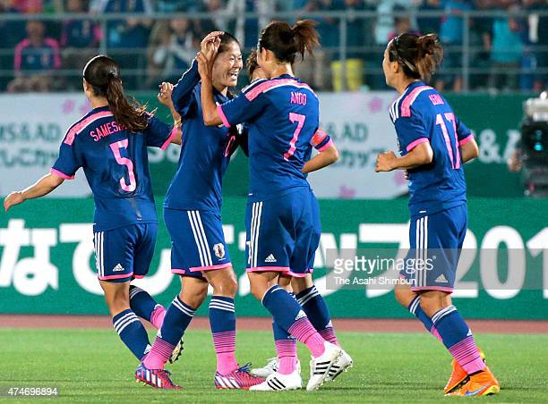 Homare Sawa of Japan celebrates scoring her team's first goal with her team mates during the women's soccer international friendly match between...