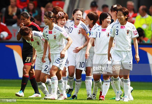 Homare Sawa of Japan celebrates with her team mates after scoring her team'S first goal during the FIFA Women's World Cup 2011 Group B match between...