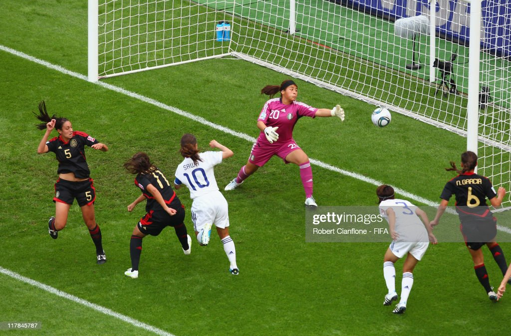 Homare Sawa #10 of Japan heads the ball beyond Mexican goalkeeper Cecilia Santiago to score during the FIFA Women's World Cup 2011 Group B match between Japan and Mexico at the BayArena on July 1, 2011 in Leverkusen, Germany.