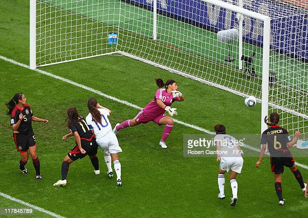 Homare Sawa of Japan heads the ball beyond Mexican goalkeeper Cecilia Santiago to score during the FIFA Women's World Cup 2011 Group B match between...
