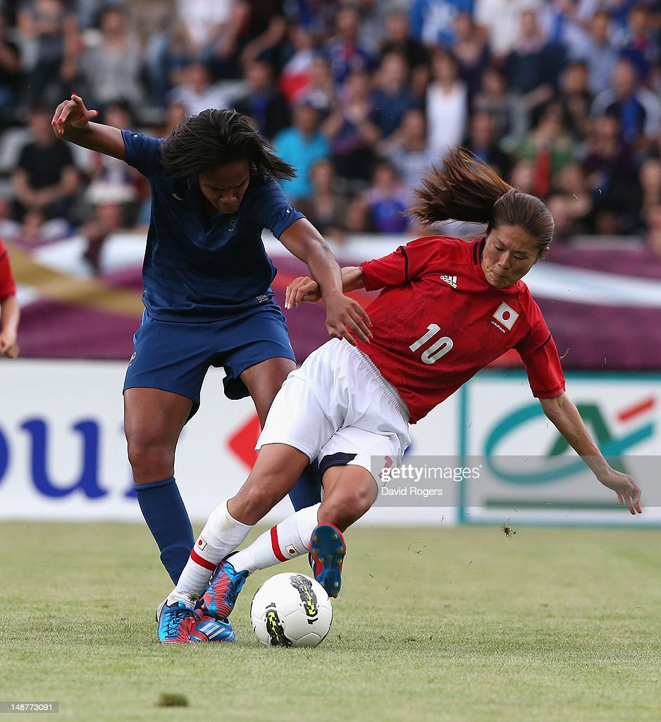 Homare Sawa of Japan is challenged by Wendie Renard during the friendly international match between Japan Women and France Women at Stade Charlety on July 19, 2012 in Paris, France.