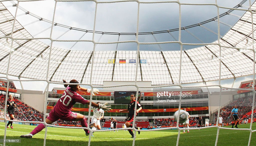 Homare Sawa (C) of Japan scores her team's fourth goal during the FIFA Women's World Cup 2011 Group B match between Japan and Mexico at BayArena on July 1, 2011 in Leverkusen, Germany.
