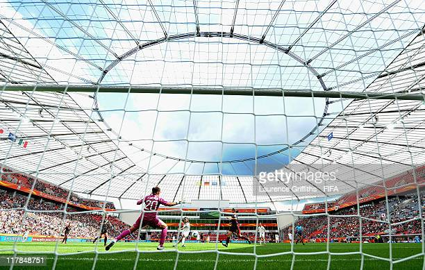 Homare Sawa of Japan scores the fourth goal during the FIFA Women's World Cup 2011 Group B match between Japan and Mexico at the Bay Arena on July 1...