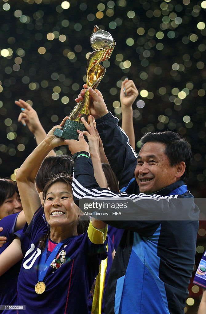 Homare Sawa the captain of Japan and Norio Sasaki the coach of Japan lift the Women's World Cup after victory over USA in the FIFA Women's World Cup Final match between Japan and USA at the FIFA Women's World Cup Stadium on July 17, 2011 in Frankfurt am Main, Germany.