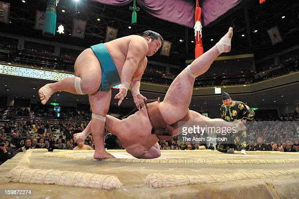 Homarefuji throws Jokoryu to win during day ten of the Grand Sumo New Year Tournament at Ryogoku Kokugikan on January 22 2013 in Tokyo Japan
