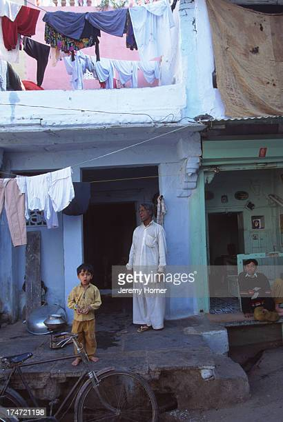 Home along the quieter back streets of Udaipur Rajasthan