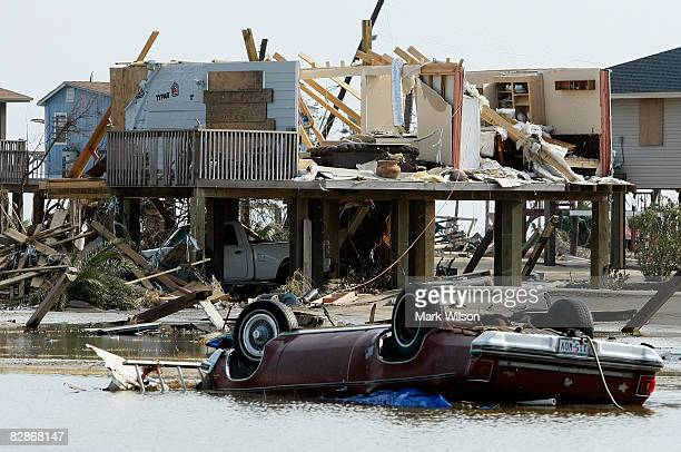 A home and a car lie destroyed by Hurricane Ike September 17 2008 in Crystal Beach Texas Hurricane Ike caused widespread damage and power outages on...