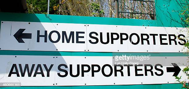 home and away supporters signs - lyn holly coorg stock pictures, royalty-free photos & images