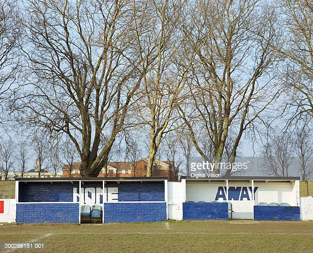 'home' and 'away' team dugouts at side of football pitch - banquillo deportivo fotografías e imágenes de stock