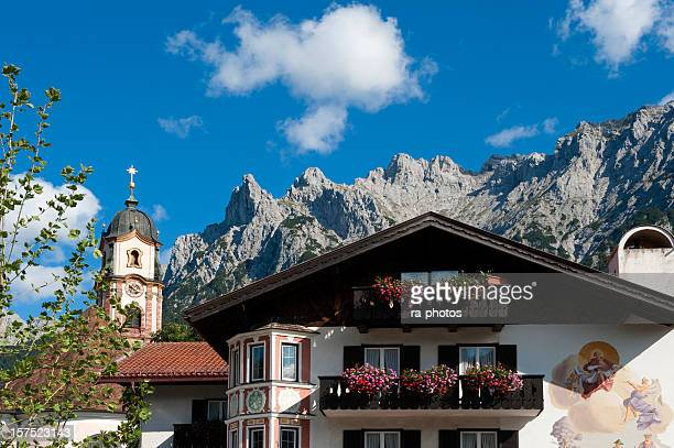 home and cliffside in mittenwald, bavaria, germany - mittenwald stock pictures, royalty-free photos & images