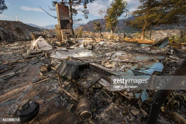 A home and property lies in ruins as it was one of three homes and a shed were destroyed in the the La Tuna Canyon fire along Crestline Drive in Los...