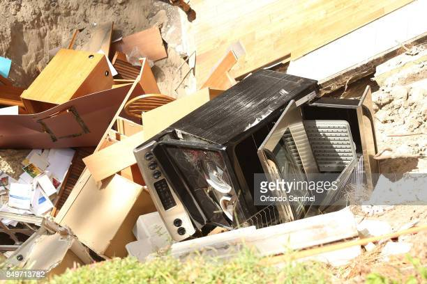 A home at 222 West Kelly Park Road in Apopka is being swallowed by a sinkhole on Tuesday Sept 19 caused by Hurricane Irma