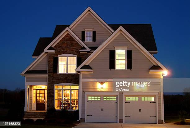 home at night - illuminated stock pictures, royalty-free photos & images
