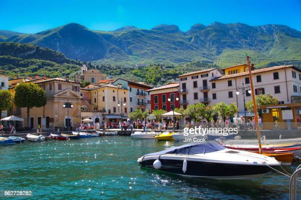 home away from home, malcesine harbor - veneto stock pictures, royalty-free photos & images