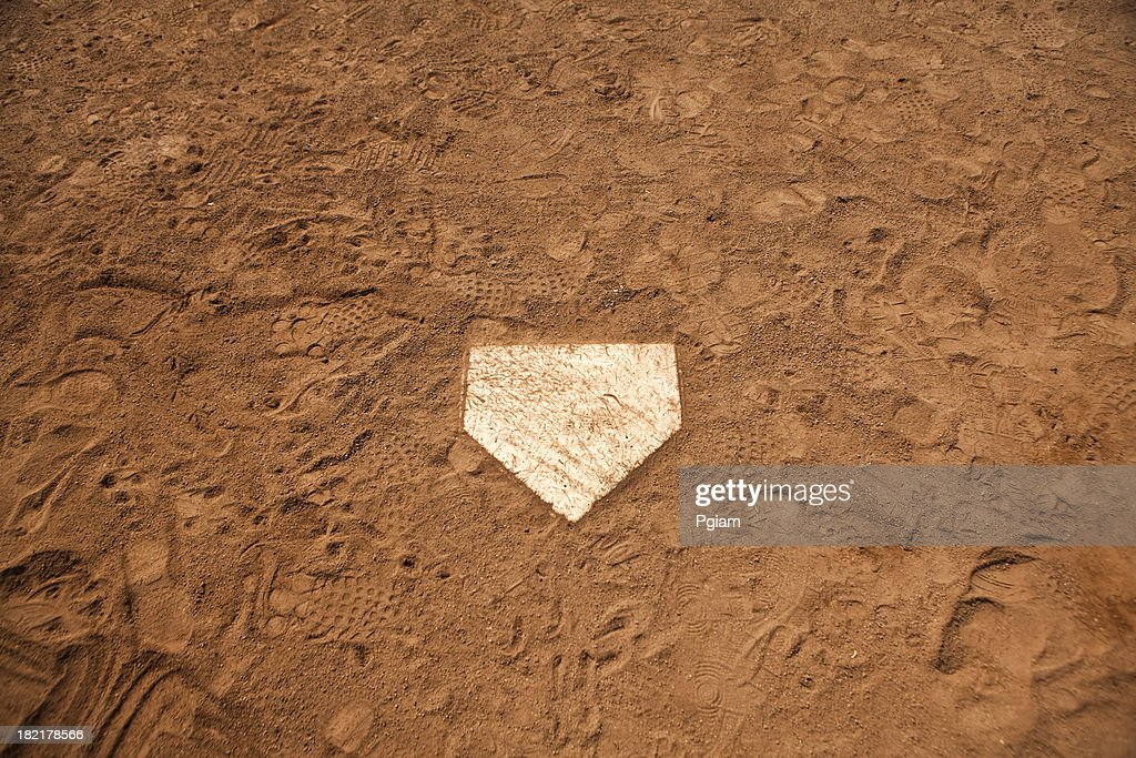 Home base plate on the diamond : Stock Photo
