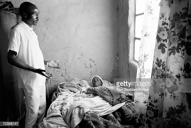 Home Based Care nurse Justin Maikana visits a patient with AIDS in the Glendale area of Zimbabwe It is estimated that 254 million people are infected...