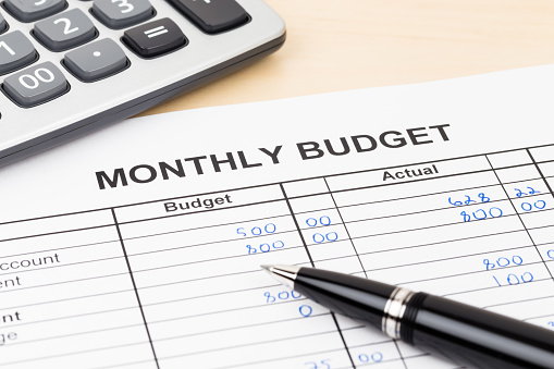 Home budget planning sheet with pen and calculator 1048332554