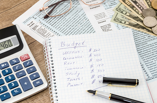 home budget with tax form, money and calculator 915636236