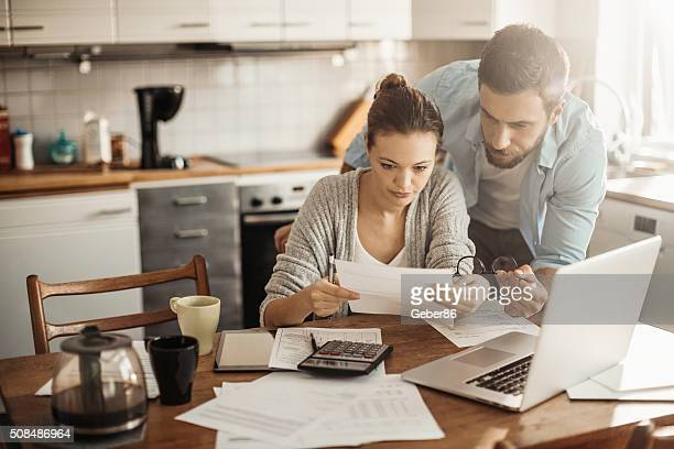 home budgeting - employment law stock photos and pictures