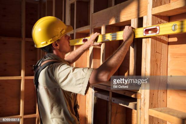 home building - measuring wall - length stock pictures, royalty-free photos & images
