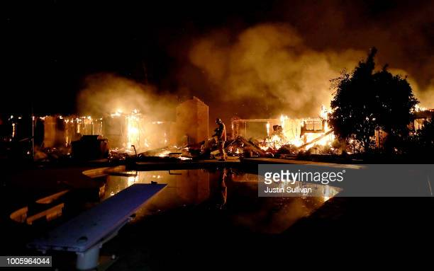 A home burns along Sunflower Road during the Carr Fire on July 27 2018 in Redding California A firefighter was killed battling the fast moving Carr...