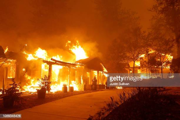 Home burns as the Camp Fire moves through the area on November 8, 2018 in Paradise, California. Fueled by high winds and low humidity, the rapidly...